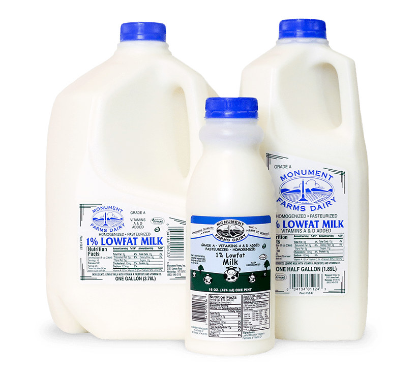 A pint, half gallon, and gallon jug of Monument Farms local 1% milk.