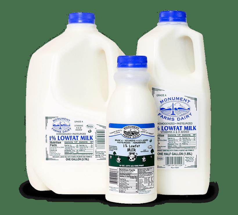 A pint, half gallon, and gallon jug of Monument Farms local 1% milk.