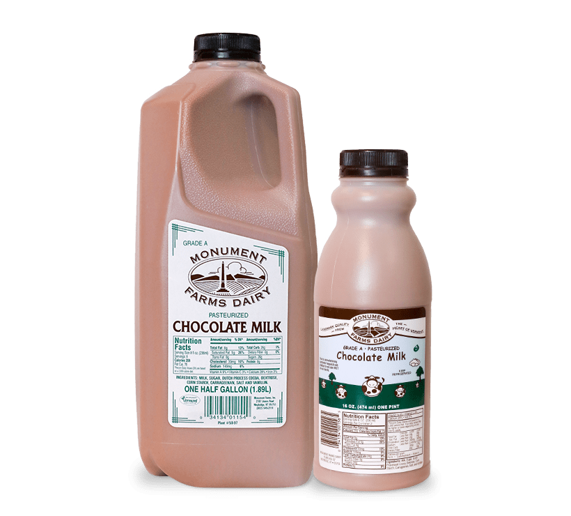 A pint and half gallon of Monument Farms whole local chocolate milk.