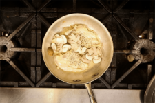 Chicken and mushrooms are added to seared chicken. Step three in the Champagne Chicken recipe shared by the chefs at Fire and Ice Restaurant as one of their local Vermont recipes made with Monument fresh local heavy cream.