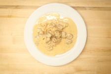 A delicious plate of chicken and mushrooms in a creamy champagne sauce, created by the chefs at Fire and Ice Restaurant as one of their local Vermont recipes made with Monument fresh local heavy cream.
