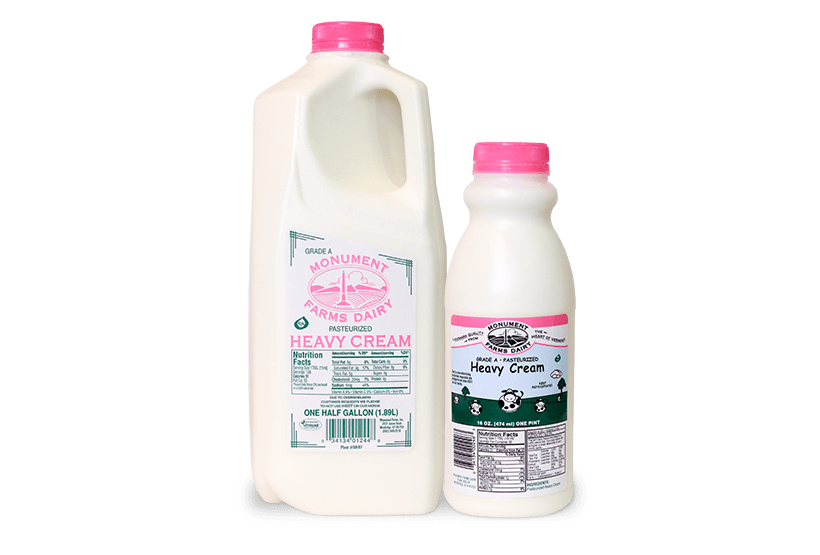 A pint and half gallon of Monument Farms local heavy cream.