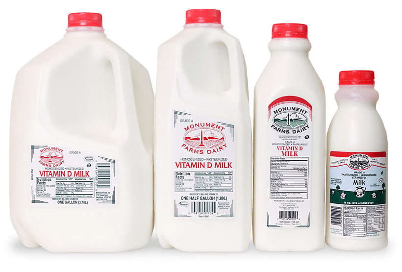 A pint, quart, half gallon, and gallon jug of Monument Farms local whole milk.