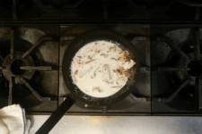 Monument fresh heavy cream cooks down into a creamy sauce over roasted chicken and bacon lardons. Step three in the Cavatappi Carbonara recipe shared by the chefs at Leunig's Bistro as one of their local Vermont recipes made with Monument fresh local heavy cream.