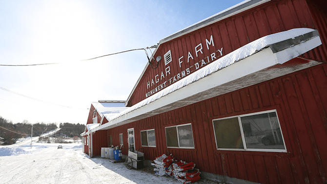 A front view of the Hagar Farm at Monument Farms Dairy where you can schedule a Vermont farm tour.
